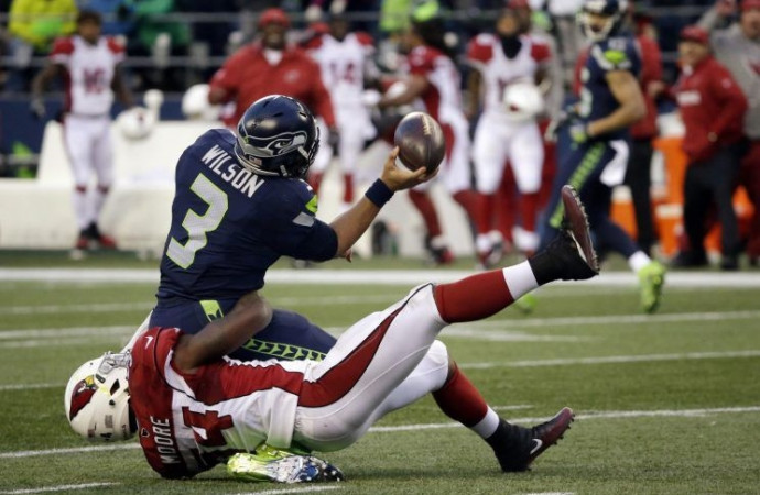 NFC playoff picture gets a huge jolt as Seahawks upset by Cardinals on final play