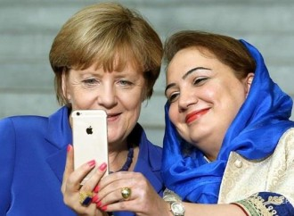 What made Angela Merkel change her stance on immigrants